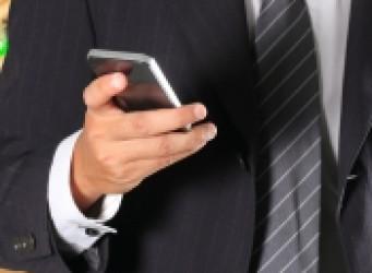 busy executive checking smart phone