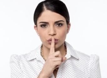 woman making hush gesture